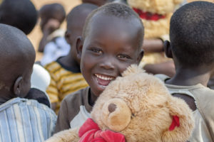 Julia Towango, 4, shows his excitement after receiving a Teddy Bear at Imvepi Refugee Settlement in Arua District in Northern Uganda 1 December 2017.